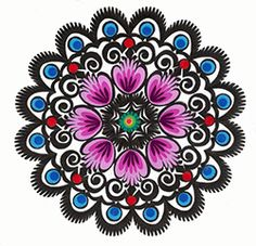 Polish paper cuts made by folk artists in the Lowicz area of central Poland, rooster, flower or geometric motifs.