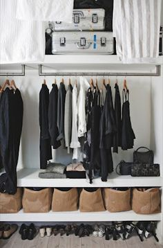 great storage underneath with shelving. also great idea to hang curtains from ceiling to block unslightly