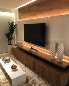 Wood backdrop and TV wall unit. Lit up TV wall unit. Sophisticated and simple TV wall mount design. Tv Wall Mount Designs, Tv Wall Design, Tv Wanddekor, Living Room Tv Unit Designs, Modern Tv Wall Units, Modern Wall, Tv Cabinet Design, Simple Tv, Cozy Family Rooms
