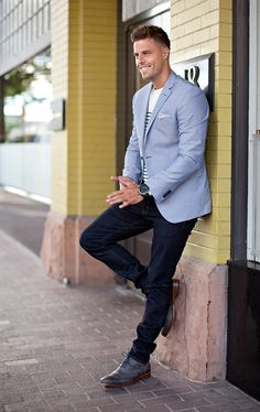 Dark wash denim, grey wingtip oxfords, blue blazer, nautical stripe tee, and a pocket square. Casual Men's