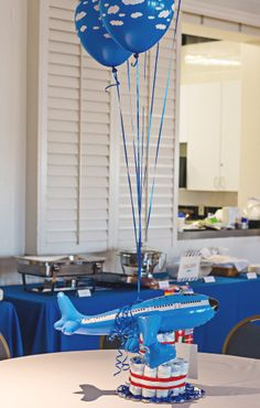 Table centre pieces- cute blow up planes - Travel Themed Baby Shower