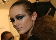 Intense true carbon smokey eye. Love this look, especially with the sleek pony tail.