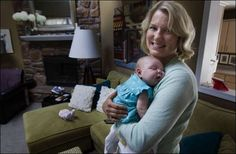Sarah Baker holds her baby Harper Leigh Baker.  Baker received a pancreas transplant three years ago which cured her diabetes and made having a healthy baby possible.