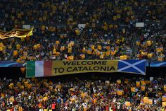 Supporters hold up the Catalan flag during the UEFA Champions League Group C match between FC Barcelona and Celtic FC at Camp Nou on September 13, 2016 in Barcelona, Catalonia.