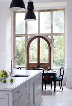 white kitchen + amazing arched door & windows