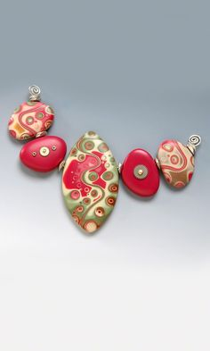 Julie Picarello/ Do you think you could modge podge some craft paper on some stones? Would that work?