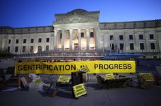 Now There's Caution Tape To Warn Of The Dangers Of Gentrification | An artist priced out of her New York neighborhood is fighting back.The Artist's Studio Affordability Project was one of many protesting gentrification during a real estate summit at the Brooklyn Museum on Nov. 17.