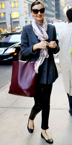 Miranda Kerr  WHAT SHE WORE  Kerr shopped N.Y.C. in leather pants and a wool blazer, accessorized with a burgundy Celine tote and ballet flats