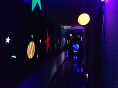 Blast off VBS.   Hallway  decor.    We painted cardboard with neon paint and used black lights to make it glow.