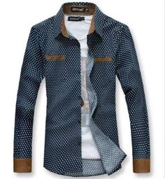 It is a shirt with white polka dots, it is blue, its origin is Spain, is fabric and has a molded in gray with white polka dots