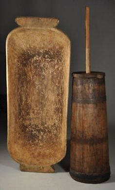 Offered antique wooden dough bowl ( measurements ) and great condition working antique wooden butter churn (measures 17 inches in height and inches with the dasher.