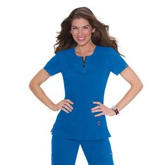 Koi Serenity Scrub Top in Royal Blue The Serenity Top is part of the Koi Lite range meaning easy wash and wear, lightweight material and no wrinkles. This fitted, athletic style top features a comfortable rib knit trim on the sides. The top has a vertical texture making the fabric lightweight and non-clingy. £29.99   #medicalscrubs #nursescrubs #dentistscrubs #nurses #dentists #bluescrubs #nurseuniform