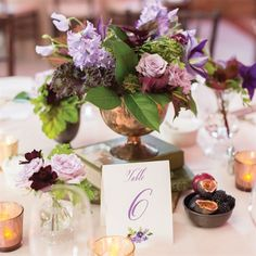 Flower and book centerpieces.  Use meaningful book titles to complete your theme. #vintage #wedding ❘ The Yacht Club at Marina Shores @The Yacht Club at Marina Shores #virginiabeach