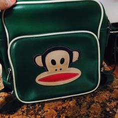 Authentic Paul frank green crossbody bag Authentic Paul frank green cross body  bag in good condition no rips or tears has some small nicks and scratches but still in good condition Paul Frank Bags Shoulder Bags