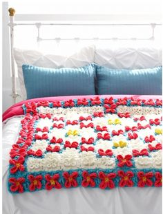 Flowerific Afghan - is an amazing addition to a child's room. Full of three dimensional flower crochet motifs, kids will love this cute afghan. Once you learn how to crochet this flower motif, you won't be able to put your hook down!