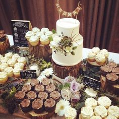 rustic woodland wedding cake and dessert table                              …