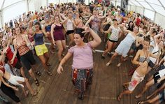 Revellers attend a dance workshop during the Pohoda music festival at Trencin airport 130 km (81 miles) north of Bratislava, July 7, 2012. Pohoda, the largest Slovak open-air music festival, is attended almost 30.000 of visitors.