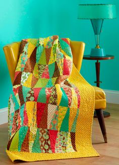 I need to quilt with more aqua, yellow, and red. Obviously.