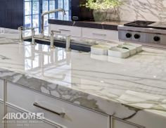 Contemporary and clean, a Calcutta Gold marble countertop lends flair to this modern Winnetka, Illinois kitchen.
