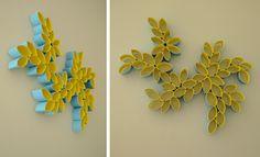 kreative wandgestaltung mit Papphülsen als wanddekoration selber machen in blau und gelb