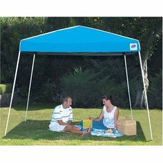 "International E-z up SE2S12BLDRB7 Sierra Shelter 12' X 12' Blue by E-Z UP. $149.99. 12' x 12'. Valance height 6'1"". 300 x 300 textured polyster fabric top. Powder coated steel frame. Blue. ""E-Z UP"" SIERRA INSTANT SHELTER  Blue   12' x 12'  Valance height 6'1""   Powder coated steel frame   300 x 300 textured polyster fabric top   Silver UV coated roof   Includes frame, top, roller bag & stake kit   Fire retardent   Boxed"