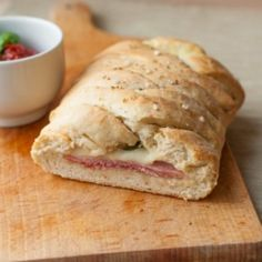 Pizza Stromboli. Delicious Stromboli pizza filled with greens ham and cheese. (i...