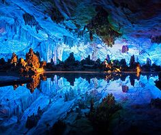 Reed Flute Cave, China  This almost 800-foot-long limestone karst cave housed an impressive collection of stalactites and stalagmites even...