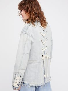 Denim Lace-Up Jacket | Oversized denim jacket featuring statement lace-up detailing on the back and sleeves.    * Front cargo pockets   * Raw trim along the hem   * Hidden button closures down the front