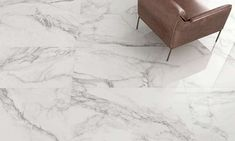 The newly introduced Blanco Marble large format porcelain tile emulates Carrara marble with a thick network of grey veins on a white background. Available in an imposing 1520 x 760 mm format with a polished finish. Wooden Crates, Carrara Marble, Stone Tiles, Large Format, Porcelain Tile, Floor, Grey, Wall, Wood Boxes
