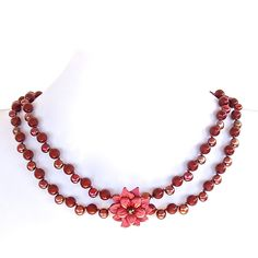 """This romantic 'Marsala red flower necklace of Swarovski glass pearls and freshwater pearls is accented with an alluring flower pendant. This 18"""" standout is available online now."""