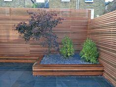 panneau occultant de jardin en bois, lattes en bois horizontales