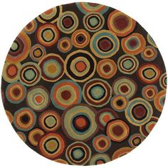 A contemporary design and warm tones adorn this hand-tufted wool rug. Orange, black, gold, mustard, and blue hues highlight the plush pile of this brown rug. Primary materials: New Zealand wool Pile h