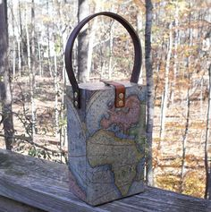 """Steampunk Adventurer Map"" Case Cigar Box. Features reproduction antique world maps that have been crinkle decoupaged with a matte water resistant finish. A re-purposed, upcycled leather belt section makes a comfy carry strap for this snap-closure creation"