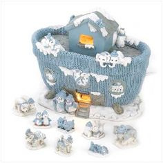 """Snow Buddies Noah's Ark  A storybook classic comes to life in this whimsical wintry light-up figurine! The famous ark is shown here in a snugly knitted stocking texture, while """"Snow-ah"""" and his animal pals prepare to board. Includes 8 animal pair figurines: Turtles, Lions, Penguins, Seals, Pigs, Zebras, Deer, Polar Bears. Weight 3.6 lbs. UL Recognized 7 3/4"""" x 4 1/2"""" x 6 1/2"""" high. Resin. Light bulb included. Set #15063 $55.95"""