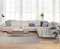 Cepella Sectional from Dania Furniture Co. - Sink into the all-around comfort of the Cepella sectional. With plenty of room for the entire family, this sectional combines a low-profile, detailed tufting, wide track arms with chrome legs that looks great from every angle.