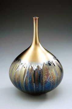 Hideaki Miyamura  vase with black and gold glaze  saw at ACC - said uses tenmoku for base glaze often
