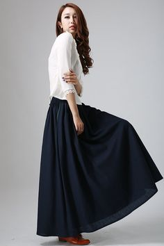 This Dark blue maxi skirt is So Feminine and Chic , Handcrafted with soft linen fabric, The wide waist band and gathered pleated design make this skrit a flare silhouette, And the pockets with contrast piping detail make this maxi linen dress so Unique, Wear this skrit for your next weekend.