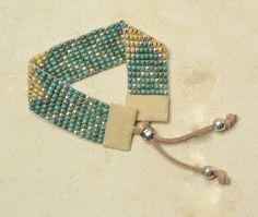 Tricks to Looming and Bead Weaving. I have to make one in the morning!