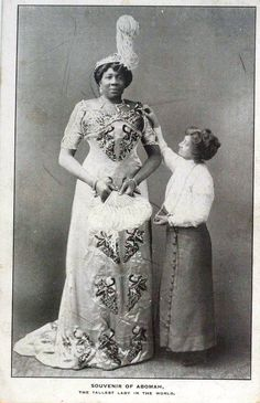 """Mme. Abomah (born 1862?) was known as the Amazon Giantess and the African Giantess. She has traveled all over the world as the tallest woman in the world: Australia, New Zealand, South America, France, Italy, Switzerland, Belgium, Germany, England, Scotland and Ireland. She was billed as being 7'6"""" tall, but photographic evidence suggests she was more in the 6'10"""" - 6'11"""" range... ."""