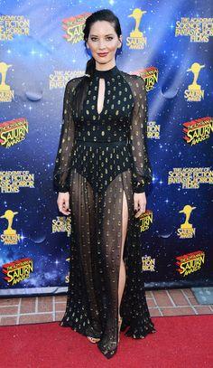 Olivia Munn in a black chiffon long-sleeve dress