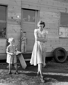 "Young mother, twenty five, says ""Next year we'll be painted and have a lawn and flowers.""  Rural shacktown, near Klamath Falls, Oregon.  September 1939.- DOROTHEA LANGE'S photographs tell stories. Sometimes uneasy tales of hard work, poor living conditions, and the resulting despair. But most capture the inner strength and pride of Lange's subjects despite their impoverished surroundings. -  Melissa Steineger"