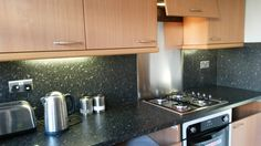 This is a kitchen revamp the kitchen specialist glasgow did this week. We originally did this kitchen 15 years ago but was in need of a little updating. Worktops and splashbacks (including stainless steel cooker splashback) and steel power sockets were all changed in this part of the kitchen!
