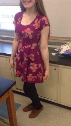 Today's outfit! A floral purple skater dress with black tights and brown shoes.