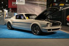 """Can you even count all of the custom details? Marc's incredible 1965 """"Vapor"""" Mustang was built by our friends at Roadster Shop and earned a coveted Ford Design award, at the 2016 SEMA Show! It's powered by a 785HP Edelbrock-supercharged Coyote V8 and rides on the Forgeline Flush-Loc Centerlock Conversion Kit and center locking 18x9.5/19x12 Forgeline one piece forged monoblock RB1 wheels finished in Matte Graphite! See more at: http://www.forgeline.com/customer_gallery_view.php?cvk=1787…"""