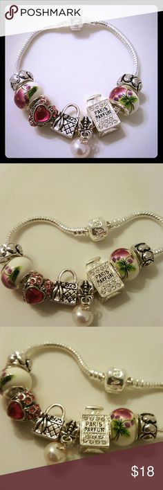 European Charm Bracelet Hand made european charm bracelet, 18cm plated silver love clasp. Brand new. Acrylic beads has 925 silver stamp, rhinestone charms and antique silver charms . Fit standard pandora bracelet. Also available in 18cm love clasp, and 21cm adjustable lobster clasp.  *Listed as Pandora for exposure* pandora  Jewelry Bracelets