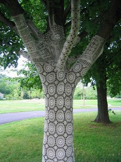 Lace doily bombed tree in Canada- wish I had the patience to do this. Result is really magical!