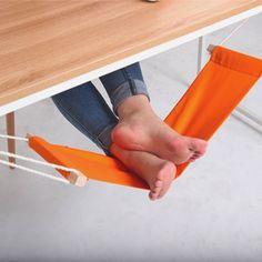 This unique hammock design replaces that extra chair you use to prop your feet up. The Fuut foot rest is a desk hammock designed specifically for resting your feet.  It hooks onto either side of any desk with two metallic clips.  You can adjust the length of the the rope from 200 mm to 450 mm.  Made from cotton, steel, & polyethylene. Please allow 4-6 weeks for shipping.