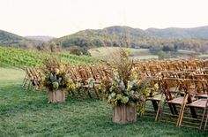 bamboo chairs. Feels like a country wedding, with a hippie twist. That's exactly how I want my wedding to feel.