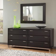 Elegant And Stunning Black Grey Dresser With Stainless Steel Handles Decorated Green Gl Containers A Tray Also Paired