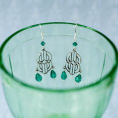 Charming Art Deco-style earrings reminiscent of the famous leadlight windows of the 1920s. Crafted with genuine crystal teardrops in emerald green.